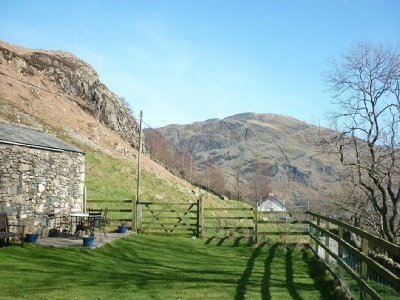 The Garden of 1 Helvellyn Cottage with views of the fells and towards Ullswater